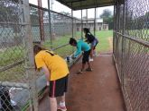 Volunteers at work in one of the dugouts at the Wahiawa Softball Field.