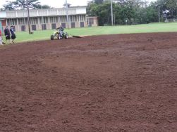 One of the finishing touches to smoothing out the Wahiawa Softball Field.