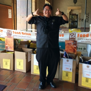 Honolulu City Council Liaison Brandon Mitsuda with over 500 pounds of food donated by councilmembers and staff.