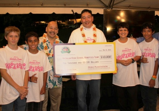 Council Chair Ernie Martin with Waialua robotics teacher Glenn Lee and a few of the Waialua robotics students.