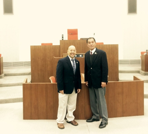 Chigasaki Council Chairman Hiroshi Aoki and Council Chair Ernest Martin in the Chigasaki City Council Chamber.