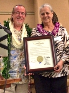 Joe Green, 2015 North Shore Chamber of Commerce Kamaaina of the Year with a Honolulu City Council Honorary Certificate from Council Chair Ernest Martin presented by Laura Figueira, Council Chair Martin's Executive Assistant.