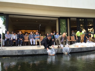 Nagaoka City Council Chairman Masashi Seki and Honolulu City Council Chair Ernie Martin Releasing Nishikigoi Donated by the City of Nagaoka to the Sheraton Waikiki Hotel.