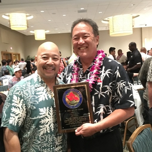 Congratulations to Leilehua High School Athletic Director Jimmy Toyota. He received a ten year service award from the Oahu Interscholastic Association.